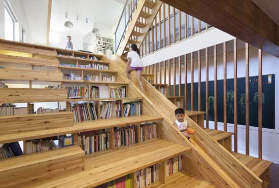 Modern-House-with-a-slide-and-Bookshelf-Stairs