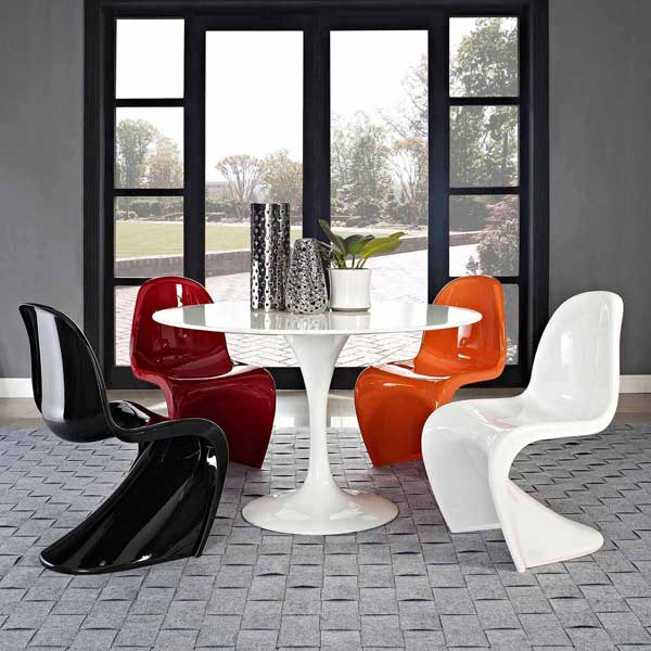 This E Age Chair Is Made From A Single Piece Of Molded Plastic Which Forms The Backrest Seat And Legs